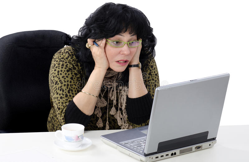 She does not understand online lesson. Mature woman does not understand online lesson stock photo