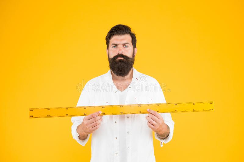 Does size really matter. Man bearded hipster holding ruler. Measure length. Size tall and length. Big size. Measure and. Control. Geometry theorem. Actual size royalty free stock photography
