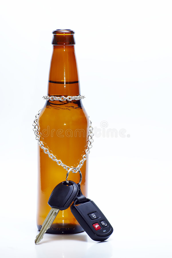 Doesn't Mix series. Car key chained to a beer bottle royalty free stock photography