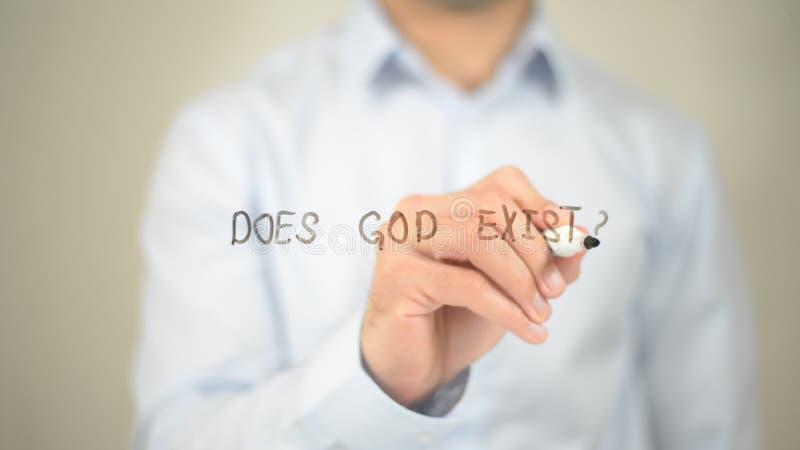 Doet God bestaan, Mens die op het transparante scherm schrijft stock foto's