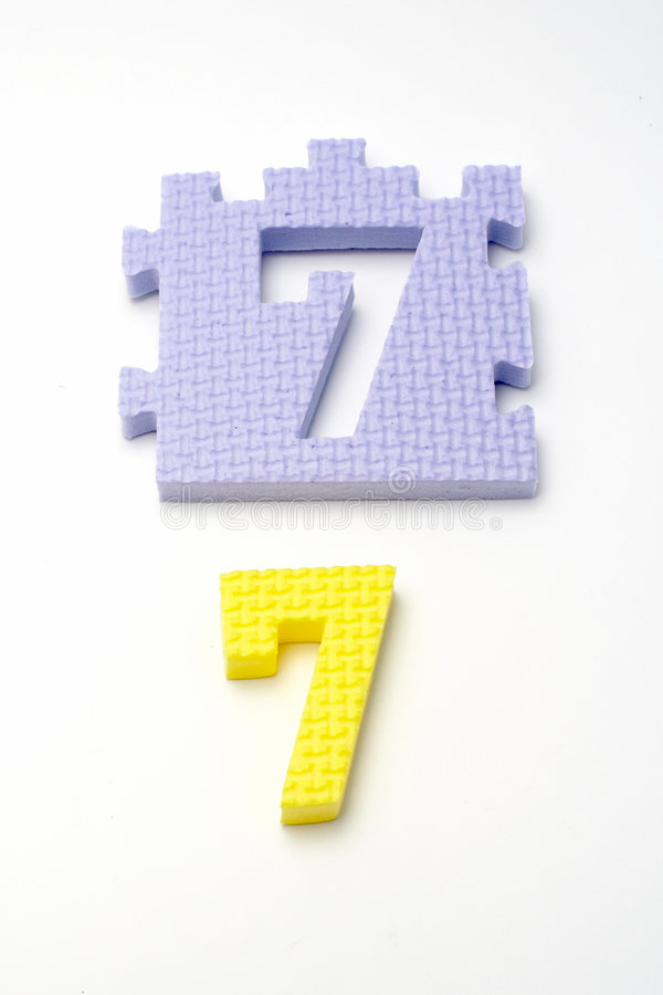 dof front ogniska mat liczby układanki siedem mała zdjęcie stock