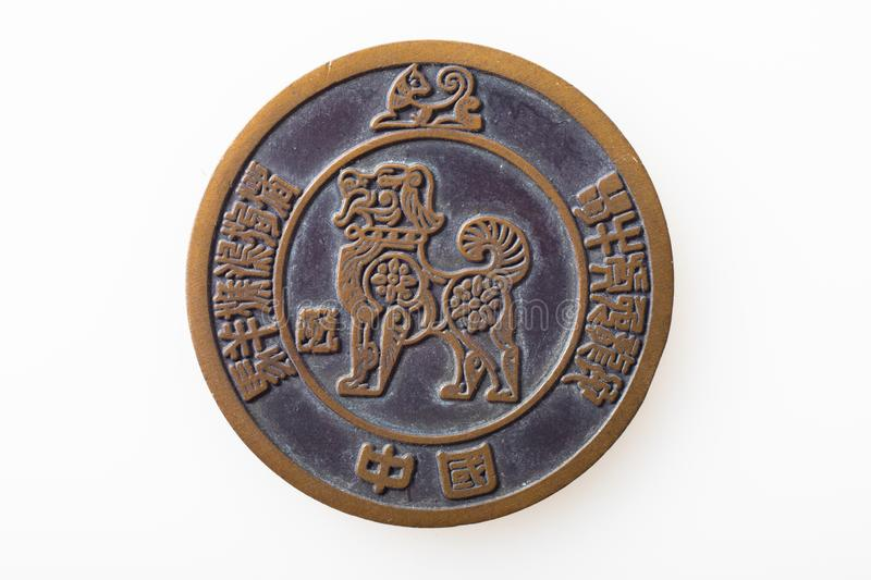 Dog animal zodiac sign in a coin with white background. The Dog is eleventh of the 12-year cycle of animals which appear in the Chinese zodiac related to the stock images