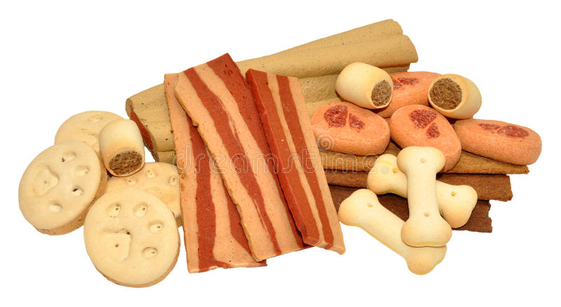 Dog Biscuits And Treats. Selection of dog biscuits and treats, isolated on a white background stock photography