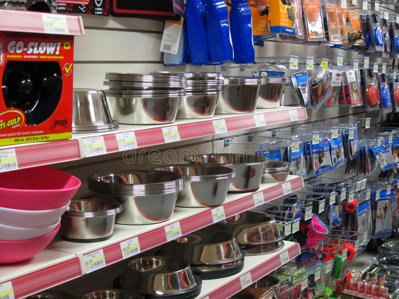 Dog bowls in a pet store. Stainless steel pet bowls on a shelf in a pet shop. Bowls for food and water royalty free stock photo
