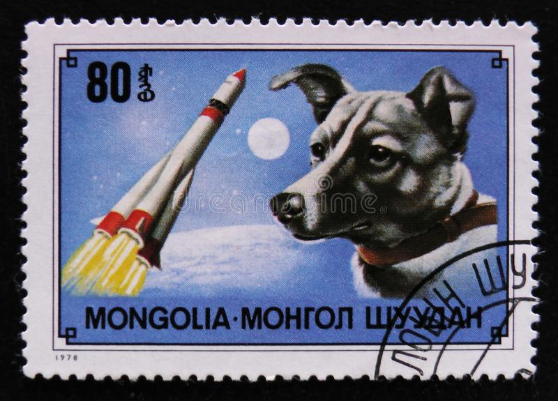 Dog breed Laika 1st dog in space and rocket, circa 1978. MOSCOW, RUSSIA - APRIL 2, 2017: A post stamp printed in Mongolia shows dog breed Laika 1st dog in space royalty free stock photography