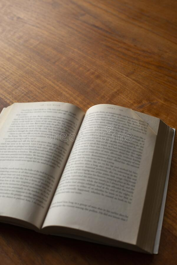 A dog eared page in a paperback on table royalty free stock photo