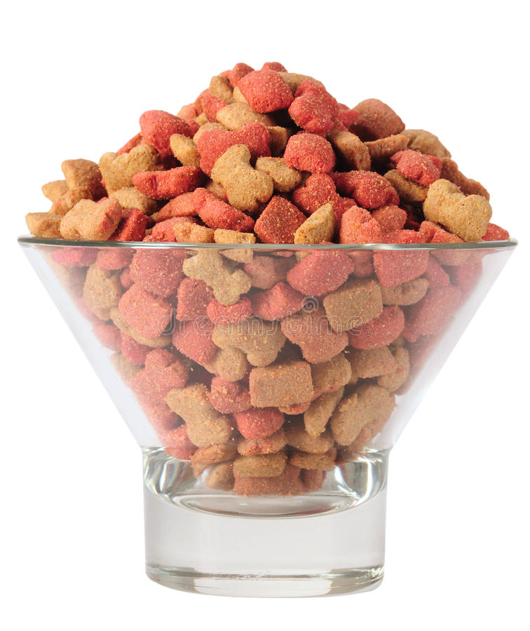 Dog food. Different shapes and flavors of dog food in crystal glass royalty free stock images