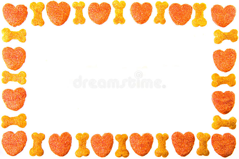 Dog food frame or border on white background,cookies with copy royalty free stock photos