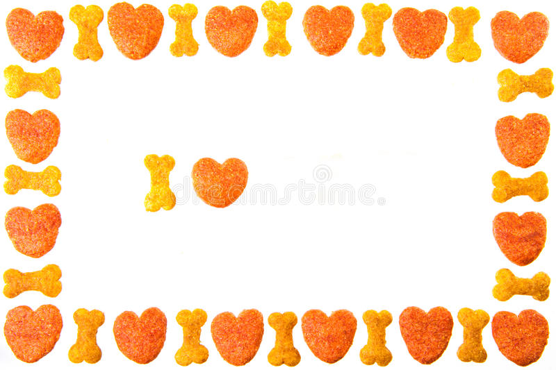 Dog food frame or border on white background,cookies with copy royalty free stock images