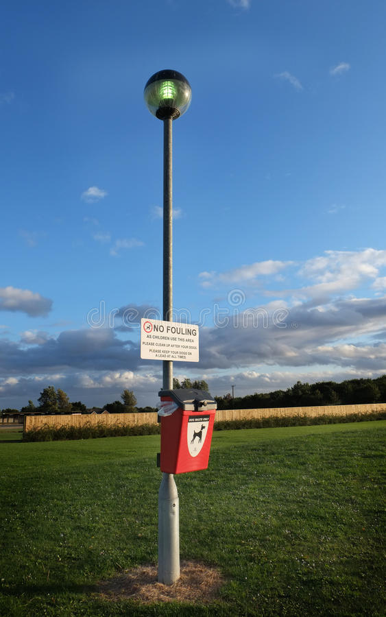 Dog fouling sign and bin. royalty free stock photography