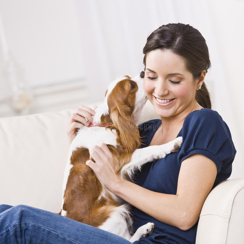 Dog Kissing Woman stock photo