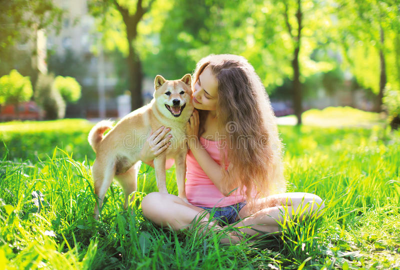 Dog and owner summer. Outdoors on the grass royalty free stock photography
