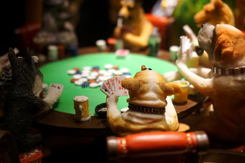 Dog poker. Dogs playing poker with many chips on table royalty free stock photos