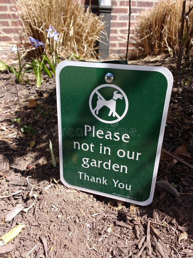 Dog Sign, Curb Your Dog, Please Not In Our Garden royalty free stock images