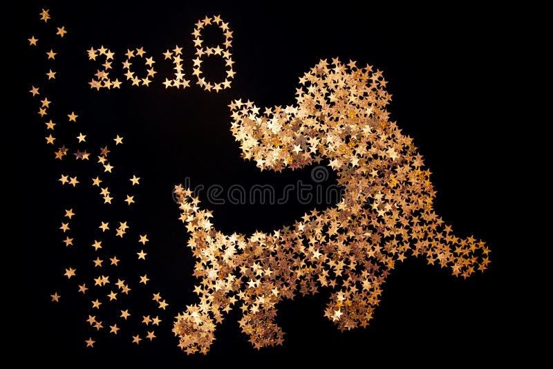Dog symbol christmas on black background. With figures 2018 stock photo