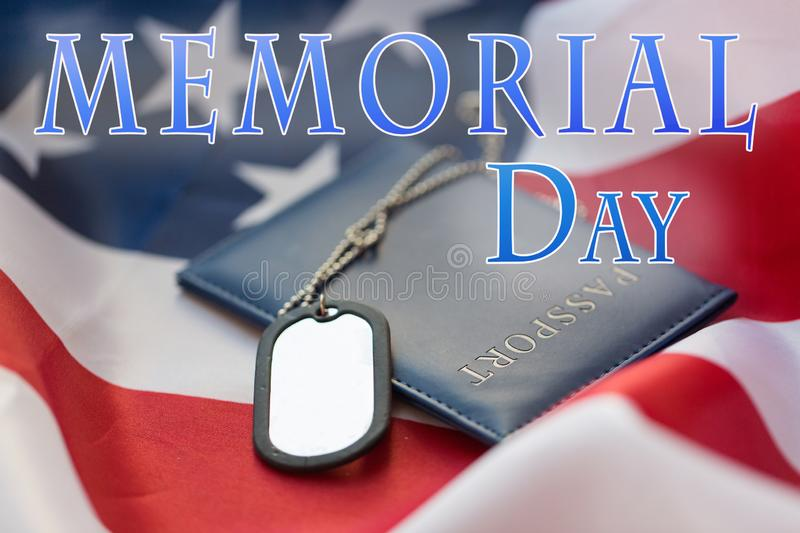 Dog tag or badge and passport on american flag. Memorial day, patriotism and military service concept - close up of dog tag or badge and passport on american royalty free stock photo