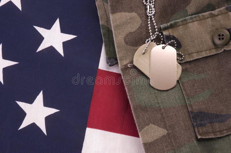 Dog Tags on Flag. Military Dog Tags on American Flag and fatigues stock image