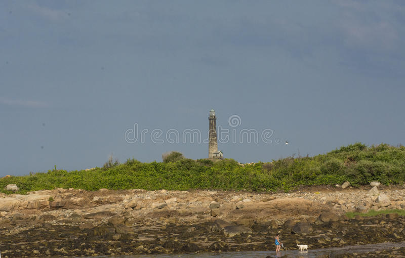 Dog Walk. This is someone walking their dog near the Thatcher Light House royalty free stock photography