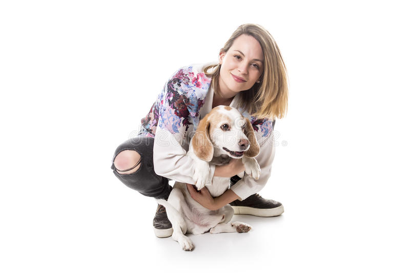 Dog with woman are posing in studio - isolated on white background. A Dog with woman are posing in studio - isolated on white background royalty free stock images