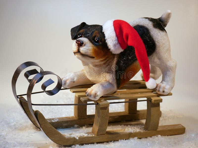 Dog on Wooden Sled Figure royalty free stock photography