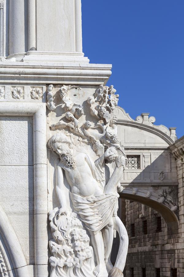 Doge`s Palace on Piazza San Marco,relief on facade and Bridge of Sighs, Venice, Italy. royalty free stock photography