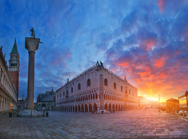 Doge`s Palace with rising sun, Venice, Italy. Breathtaking view of medieval palace at sunrise royalty free stock images