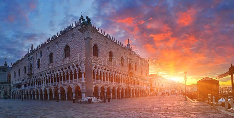 Doge`s Palace with rising sun, Venice, Italy. Breathtaking view of medieval palace at sunrise stock images