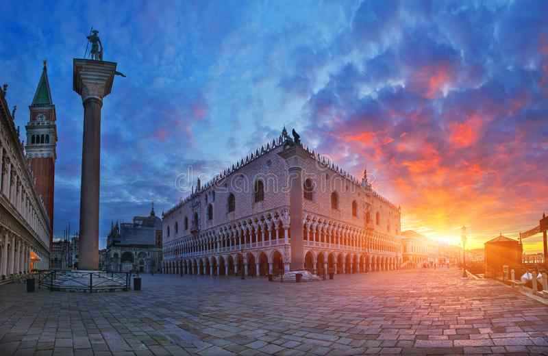 Doge`s Palace with rising sun, Venice, Italy. Breathtaking view of medieval palace at sunrise stock photos