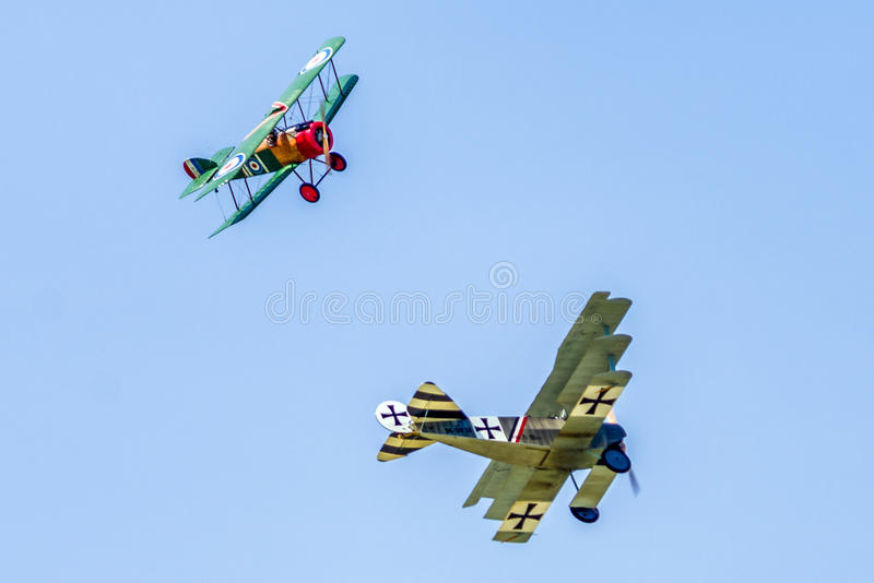 Dogfight between biplane and triplane. SLIAC, SLOVAKIA - AUGUST 27: Dogfight between biplane and triplane at airshow SIAF 2017 on August 27, 2017 in Sliac stock photo