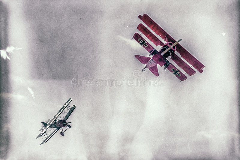 Dogfight between biplane and triplane. SLIAC, SLOVAKIA - AUGUST 27: Dogfight between biplane and triplane at airshow SIAF 2017 on August 27, 2017 in Sliac stock photos