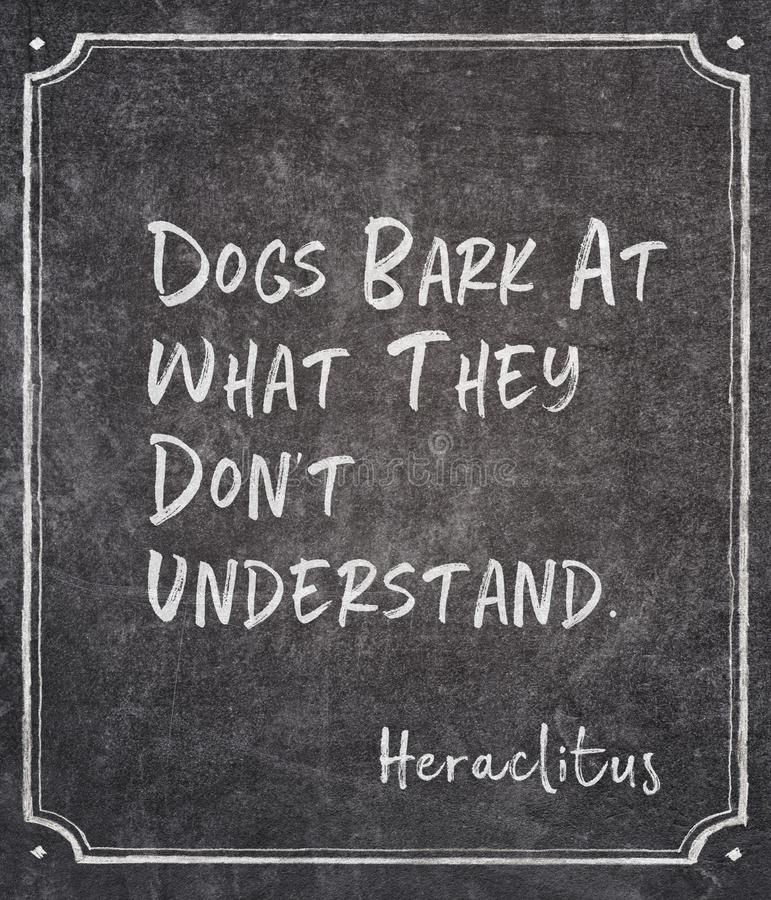Dogs bark Heraclitus quote. Dogs bark at what they don`t understand - ancient Greek philosopher Heraclitus quote written on framed chalkboard royalty free illustration