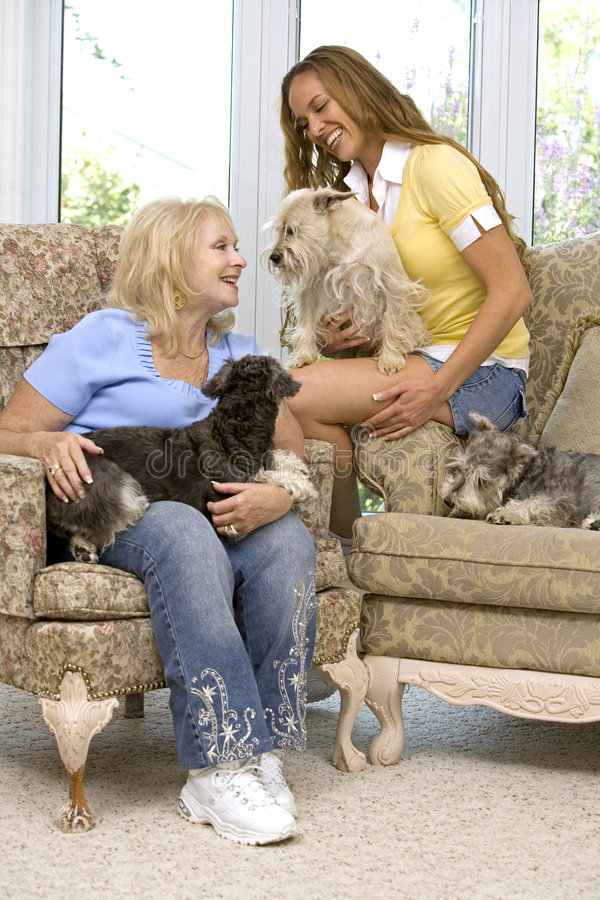 Dogs and family. Mother and daughter enjoying time with their dogs stock image