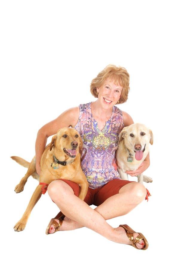 dogs kvinnan royaltyfria foton