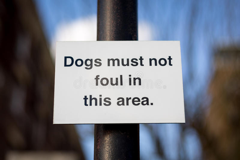 Dogs must not foul. Sign on a post that says; Dogs must not foul in this area stock photography
