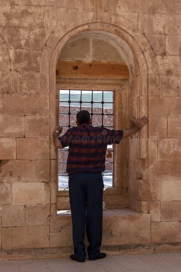 Dogubayazit, Turkey, Middle East, Ishak Pasha Palace, window, architecture, ancient, courtyard. Dogubayazit, Turkey, Middle East: a man in front of a window in a royalty free stock photos