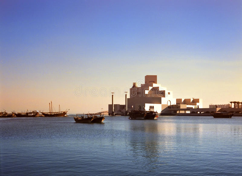 Doha harbour and museum Qatar stock photography