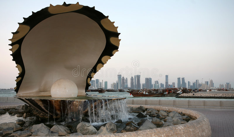 Doha pearl fountain and skyline royalty free stock photo
