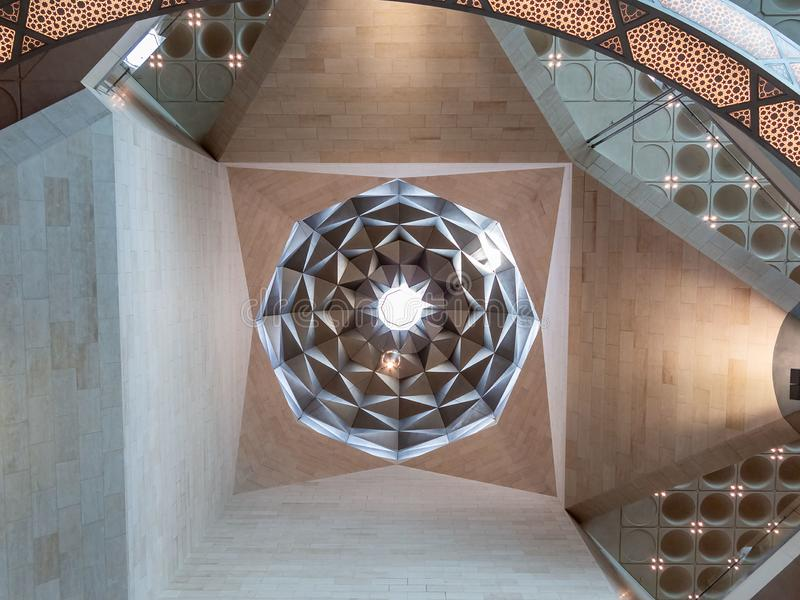 Doha, Qatar - December 20, 2018: Interior and decoration of the building of the Museum of Islamic Art, ceiling dome royalty free stock photo