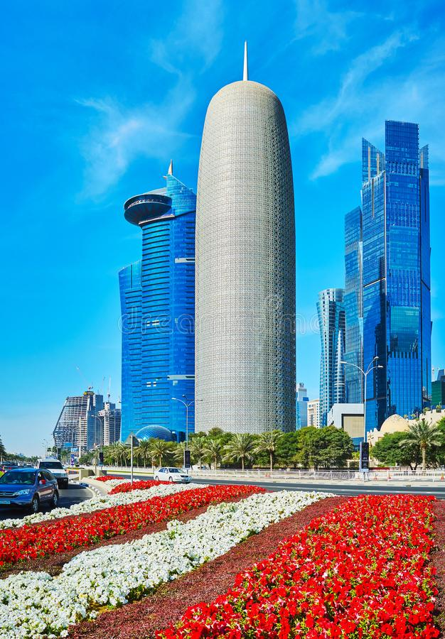 Flowers in modern Doha, Qatar. DOHA, QATAR - FEBRUARY 13, 2018: Al Dafna business district is center of modern architecture with numerous interesting skyscrapers royalty free stock photo