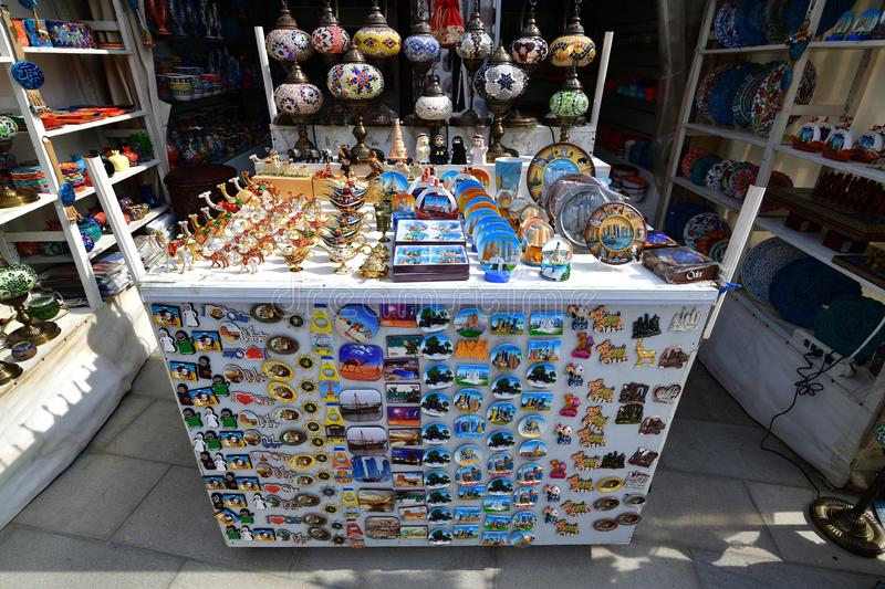 Doha, Qatar. Selling souvenirs on Souq Waqif - marketplace for selling traditional garments. Doha, Qatar. Souq Waqif - marketplace is noted for selling royalty free stock photography