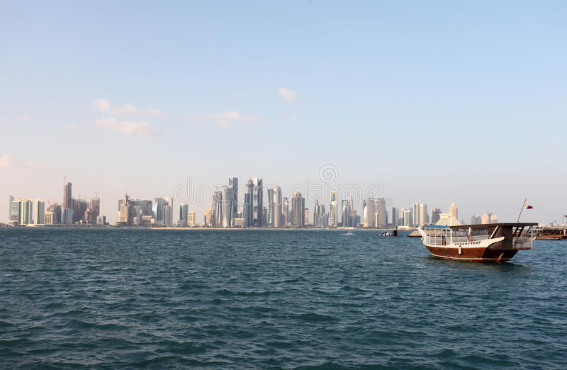 Doha skyline and dhow end 2012 stock photo