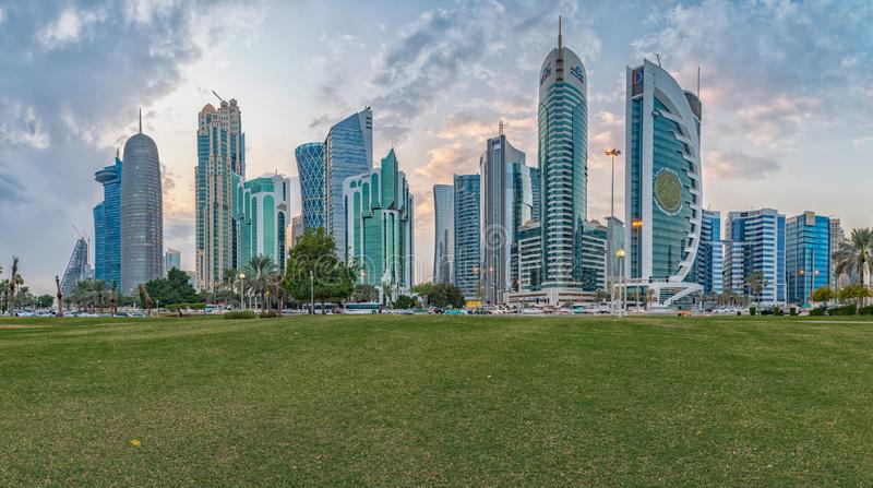 Doha skyline in West bay district daylight view with clouds in the sky. Doha,Qatar-November 10,2019: Doha skyline in West bay district daylight view with clouds royalty free stock photo