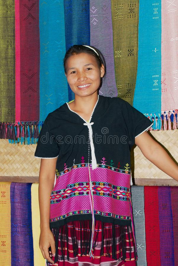 Portrait of a young women of the White Karen hill tribe wearing traditional tribe dress in Doi Inthanon, Thailand. Doi Inthanon, Thailand - November 14, 2008 royalty free stock photo