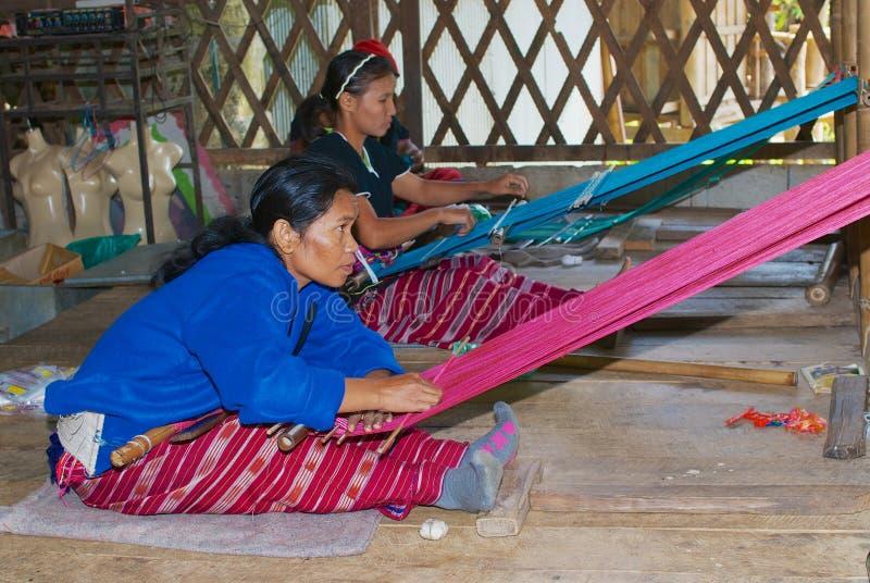 Women of the White Karen hill tribe weaving in Doi Inthanon, Thailand. Doi Inthanon, Thailand - November 14, 2008: Unidentified women of the White Karen hill stock images