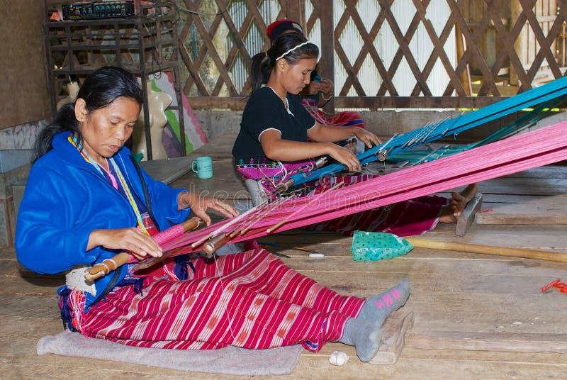 Women of the White Karen hill tribe weaving in Doi Inthanon, Thailand. Doi Inthanon, Thailand - November 14, 2008: Unidentified women of the White Karen hill royalty free stock image