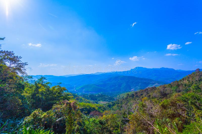 At Doi Pha Mee view point you can see Doi Nangnon in Maesai Chiang Rai shape of mountains look like women sleeping. Inside of Doi Nang Non have big and long stock photos