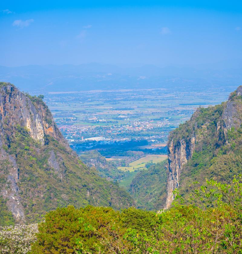 At Doi Pha Mee view point you can see Doi Nangnon in Maesai Chiang Rai shape of mountains look like women sleeping. Panorama at Doi Pha Mee view point you can stock images