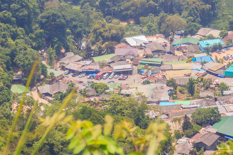 Doi Pui's Hmong ethnic hill-tribe village, aerial view from the. Cliff with green forest on the mountain background. Doi Pui Hmong tribal village is royalty free stock photos