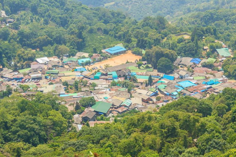 Doi Pui's Hmong ethnic hill-tribe village, aerial view from the. Cliff with green forest on the mountain background. Doi Pui Hmong tribal village is royalty free stock photography