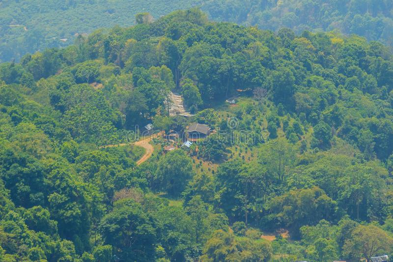 Doi Pui's Hmong ethnic hill-tribe village, aerial view from the. Cliff with green forest on the mountain background. Doi Pui Hmong tribal village is royalty free stock images